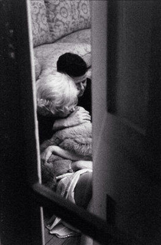 JFK and Marilyn Monroe cuddling